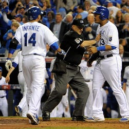 Oct 22, 2014; Kansas City, MO, USA; San Francisco Giants relief pitcher Hunter Strickland (right) is escorted back to the mound by umpire Jim Reynolds (77) in the sixth inning during game two of the 2014 World Series against the Kansas City Royals at Kauffman Stadium. Mandatory Credit: Christopher Hanewinckel-USA TODAY Sports ORG XMIT: USATSI-190094 ORIG FILE ID:  20141022_jla_ah2_329.jpg