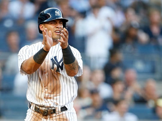 Jun 29, 2018; Bronx, NY, USA; New York Yankees second baseman Gleyber Torres (25) celebrates after scoring a run against the Boston Red Sox during the second inning at Yankee Stadium.
