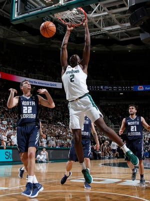 Michigan State's Jaren Jackson Jr. (2) dunks against North Florida's Trip Day (22) and Ivan Gandia-Rosa (21) during the second half of MSU's 98-66 win on Friday, Nov. 10, 2017, at Breslin Center.