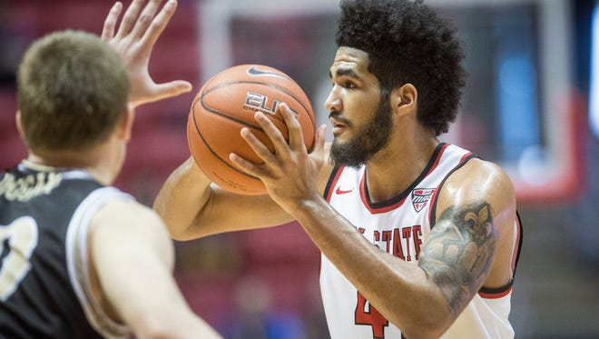 Ball State's Trey Moses tries to pass during a back and forth run with Western Michigan. Ball State defeated Western Michigan 75-71 in overtime.