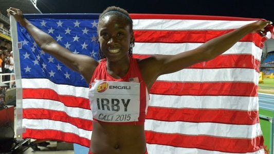 Pike High School's Lynna Irby celebrates her silver medal at the 2015 World Youth Championships.