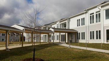 A new wing with 24 independent living apartments, right, is connected to a new parking area at Kendal at Ithaca. The first residents have moved into the expanded facility in Cayuga Heights.