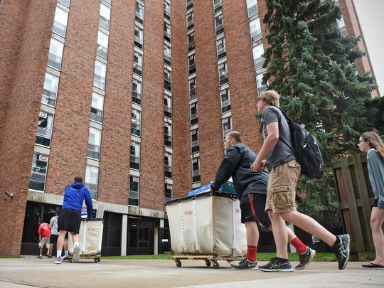 People move their belongings into Sherburne Hall Thursday, Aug. 17, 2017 during move-in day for new students at St. Cloud State University.