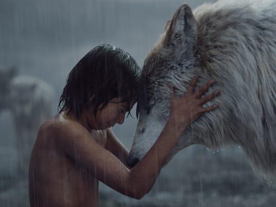 "Mowgli (Neel Sethi) and Raksha share a moment in ""The"
