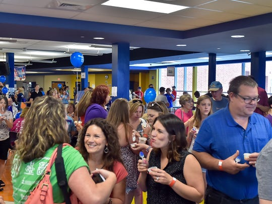 People talk and enjoy their ice cream during ChambersFest: Scoop-a-palooza on Saturday, July 9, 2016 at Chambersburg Area Senior High School.