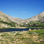 It's a 6.3-mile hike to Lawn Lake, which sits below 13,000-foot mountains Hagues Peak (right) and Fairchild Mountain. Hagues Peak, at 13,560 feet, is the highest point in Larimer County.