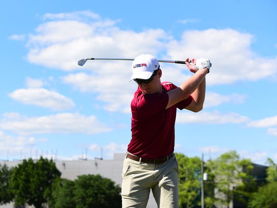 A member of the Florida State Club Golf team practices