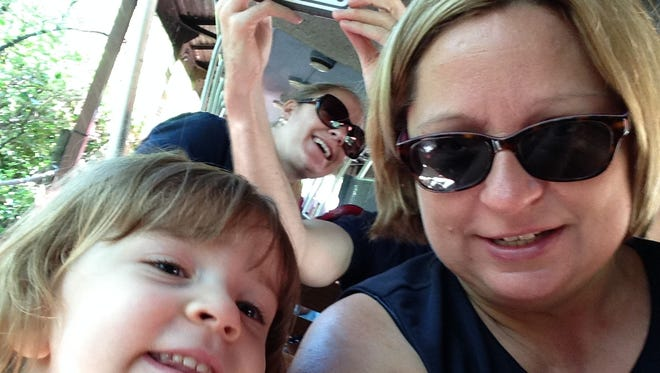 Enquirer columnist Cindi Andrews and daughter Katie Wissman, 3, take a selfie on the train at the Cincinnati Zoo & Botanical Garden recently.