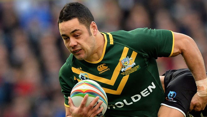 A file photo taken on Nov. 30, shows Australia's Jarryd Hayne (L) tackled during the 2013 Rugby League World Cup Final between Australia and New Zealand at Old Trafford in Manchester.  NFL franchises and US-based agents are showing serious interest in Jarryd Hayne after the Australian rugby league superstar announced an unprecendented code swap to American football, his manager said on October 17, 2014.  His manager Wayne Beavis said he had since been inundated with interest in the 26-year-old fullback, who has played 176 games for the Parramatta Eels, scoring 103 tries.