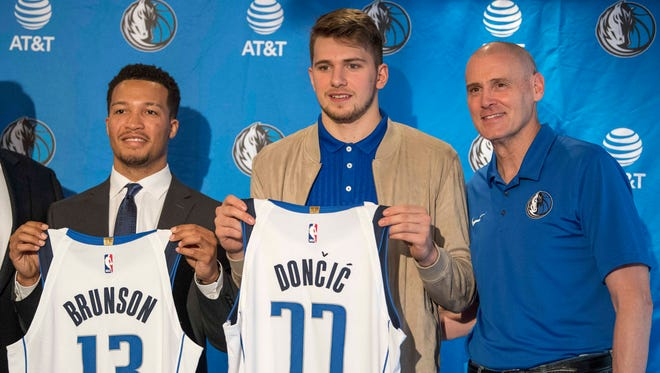 Dallas Mavericks second round pick Jalen Brunson, point guard Villanova (left) and first round pick Luka Doncic, guard Slovenia (center) and head coach Rick Carlisle (right) pose for a photo during a press conference at the American Airlines Center.