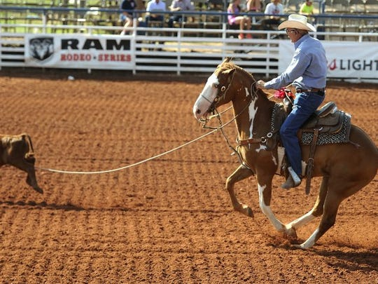 Thomas Metthe/Reporter-News Bobby Smith attempts to rope a calf during the breakaway roping at the Texas Cowboy Reunion on Saturday, July 2, 2016, in Stamford.