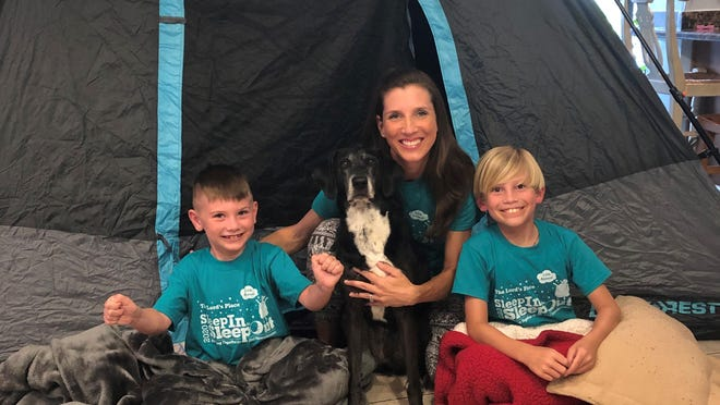 The Lord's Place Chief Advancement Officer Anne Noble, with her sons Ford, 6, and Crosby, 8 (L to R), along with their dog, Birdie, plan to participate in the 2020 Lord's Place SleepIn for SleepOut, which will take place Friday. The event will be held virtually because of coronavirus concerns.