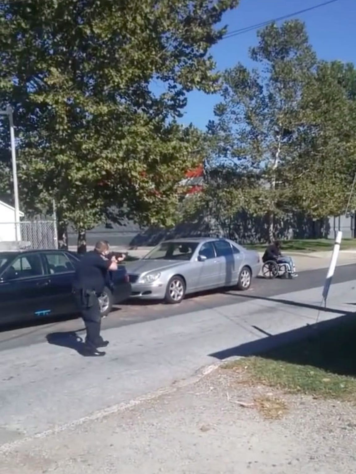 In this image taken from a cellphone video, Jeremy McDole is approached by Wilmington police in September 2015. Prosecutors said charges would not be filed against four officers involved in the shooting death of McDole.