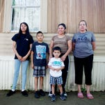 Fausta Aguilar, center, with Daniela, 14, Erik, 10 and Yair, 3, and their neighbor, Carmen Calderon, will have to leave their homes at Lakeview Mobile Home Park in South Asheville due to a planned development.