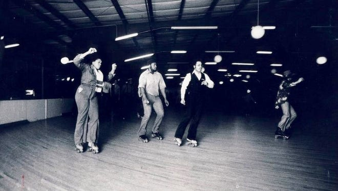 Fingers-snapping skaters slide into a turn in 1978 at Robben's Roost rink in Buechel. Bruce A. Stephenson is third from left.
