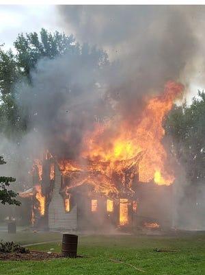 The training house burns.