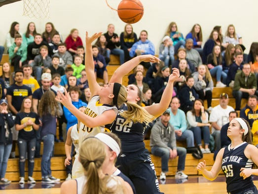 West York's Paige Weekly (52) and Morgan Wagaman, of