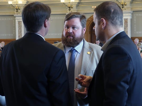 Kansas House Speaker Pro Tem Blaine Finch, center, confers with Rep. Fred Patton, left, R-Topeka, and B.J. Harden, the chief of staff to the House Majority Leader, during a debate, Friday, April 5, 2019, at the Statehouse in Topeka, Kan.