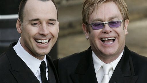 A photo from files showing pop star Elton John, right, and his longtime partner David Furnish, after they had a civil ceremony at the Guildhall in Windsor, England.  Elton John and his partner David Furnish plan to tie the knot for a second time this weekend, following the legalization of same-sex marriage in Britain. The singer's spokesman, Gary Farrow, said today, that the ceremony will be private. Same-sex couples have been allowed to marry in Britain since March. Previously, gay couples could form civil partnerships, which carried the same legal status as marriage but without the title.