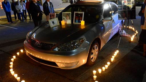 Candles surround slain pizza deliveryman Najeh Masaeid's car during a vigil to remember him in Vestavia Hills, Ala., Thursday, Dec. 25, 2014. Masaeid was killed during a robbery Sunday night. (AP Photo/AL.com, Mark Almon) MAGS OUT