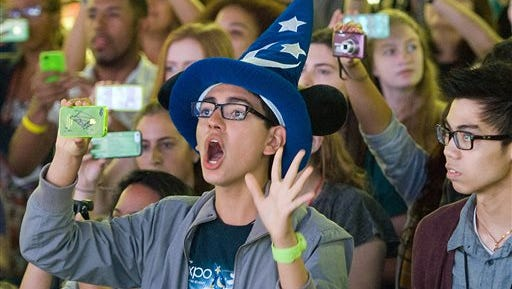 In this file photo, fans attend an event at Disneyland in Anaheim, Calif. Seven Californians and two people in Utah have confirmed cases of measles likely contracted on trips last month to Disney theme parks in California, state officials said Jan. 7.