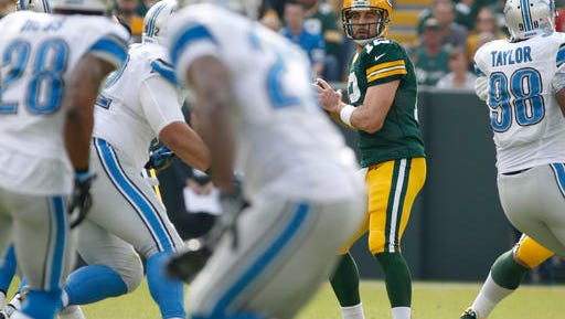 Green Bay Packers' Aaron Rodgers drops back to pass during the first half of an NFL football game against the Detroit Lions Sunday, Sept. 25, 2016, in Green Bay, Wis. (AP Photo/Mike Roemer)