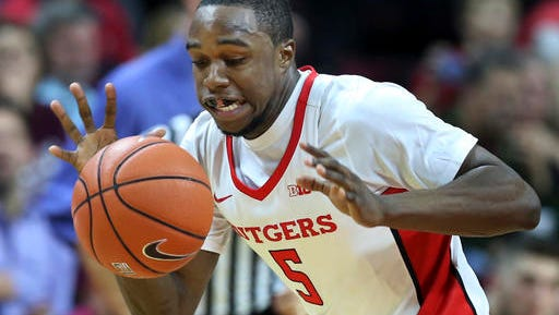 Rutgers guard Mike Williams reaches for the ball during the second half of the team's NCAA college basketball game against Molloy.