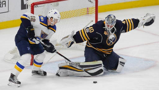 Buffalo Sabres goalie Robin Lehner (40) stops St. Louis Blues forward Jori Lehtera (12) during the third period of an NHL hockey game, Saturday, Feb. 18, 2017, in Buffalo, N.Y. (AP Photo/Jeffrey T. Barnes)