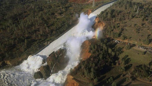 FILE - This Saturday, Feb. 11, 2017, file aerial photo released by the California Department of Water Resources shows the damaged spillway with eroded hillside in Oroville, Calif.
