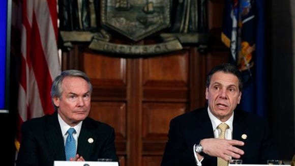 New York Gov. Andrew Cuomo, right, and Secretary to the Governor Bill Mulrow, during a cabinet meeting in the Red Room at the Capitol on Wednesday, Feb. 25, 2015, in Albany, N.Y.
