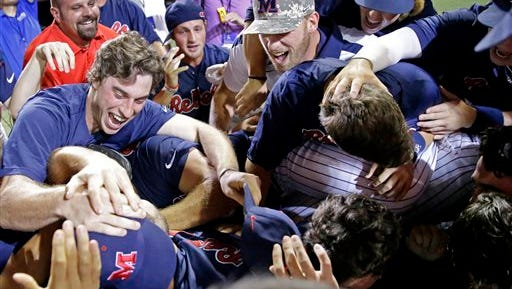 Ole Miss celebrates their victory over Louisiana Lafayette in an NCAA college baseball tournament super regional game in Lafayette, La., Monday, June 9, 2014. Mississippi won 10-4 to advance to the College World Series. (AP Photo/Gerald Herbert)