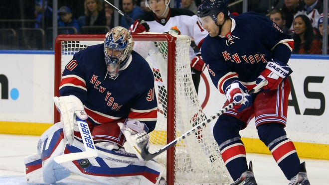 Rangers goalie Henrik Lundqvist makes a save in front of defenseman Dan Girardi during Saturday's game against the Devils at Madison Square Garden.