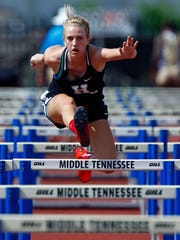 Hendersonville's Brooke Long clears a hurdle during