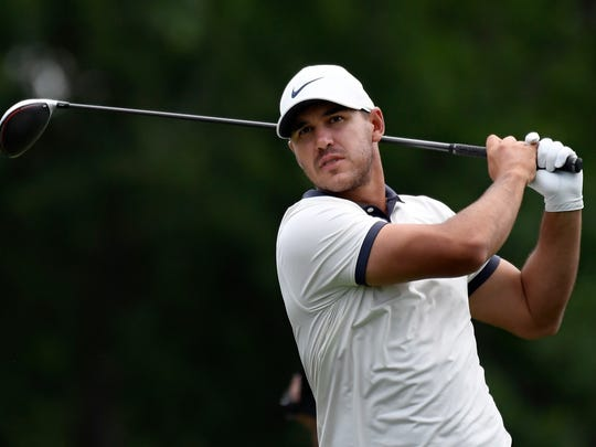 Brooks Koepka hits off the 18th tee during the third round of the Travelers Championship golf tournament, Saturday, June 22, 2019, in Cromwell, Conn. (AP Photo/Jessica Hill)