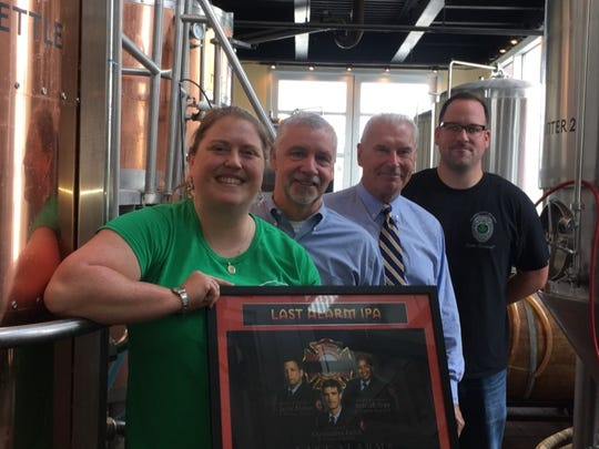 Wilmington Iron Hill brewer Moriah Guise, Iron Hill co-founder Kevin Finn, Wilmington Mayor Mike Purzycki and Wilmington firefighter Michael Stears at the re-release of Last Alarm IPA last week.