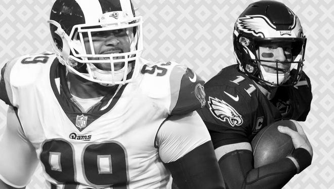 The status of Rams DL Aaron Donald (99) and Eagles QB Carson Wentz are among the NFL's major questions heading into the 2018 season.