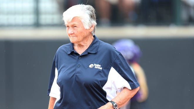 Warren Regina head coach Diane Laffey coaches third base against Caledonia in the Girls Softball Division 1 MHSAA State Championship game on Saturday, June 13, 2015. Laffey became the winningest coach in state history with Regina beating Caledonia, 5-0.