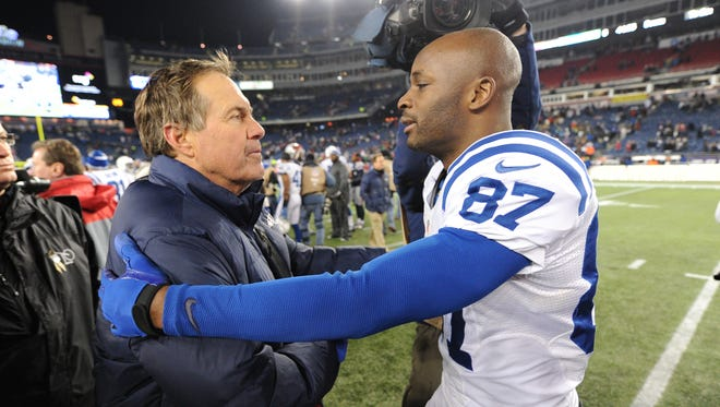 Indianapolis Colts Reggie Wayne,right, greets New England Patriots head coach Bill Belichick,left, following their game Sunday evening at Gillette Stadium in Foxobrough MA. Matt Kryger / The Star