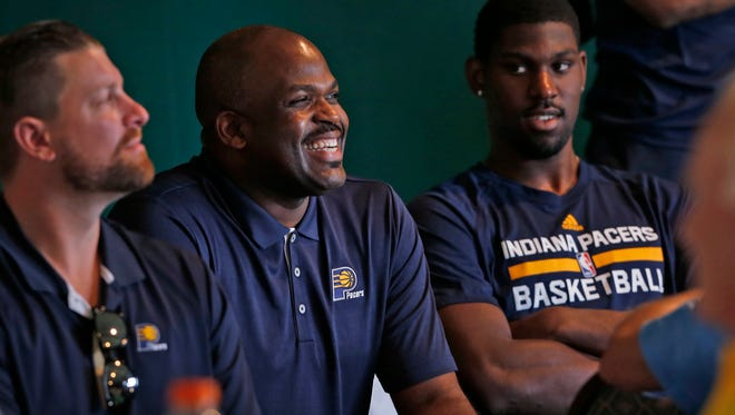 Pacers head coach Nate McMillan, center, smiles as he makes a bid during an auction at the Pacers Golf Outing, held at the Brickyard Crossing Golf Course, Wednesday, September 21, 2016.
