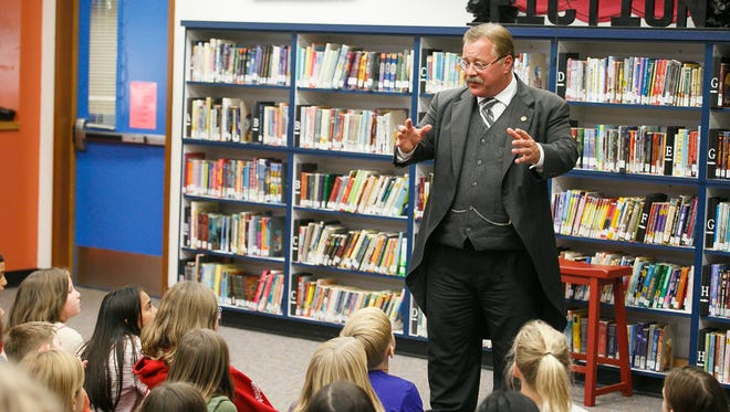 Historical recreator Joe Wiegand performs as Teddy Roosevelt for fourth and fifth graders at Wright Elementary School on Monday, Oct. 9, 2017, in Salem.
