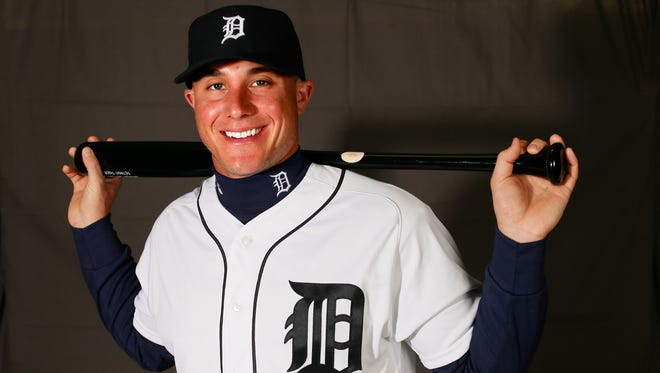 """James McCann has his picture taken in spring training in Lakeland, Fla. on Feb. 27, 2016. This version of the Old English """"D"""" on the uniform was first introduced in the 1930s and has either been a primary or alternate logo for the franchise since. Note the slight difference of the """"D"""" on the hat."""
