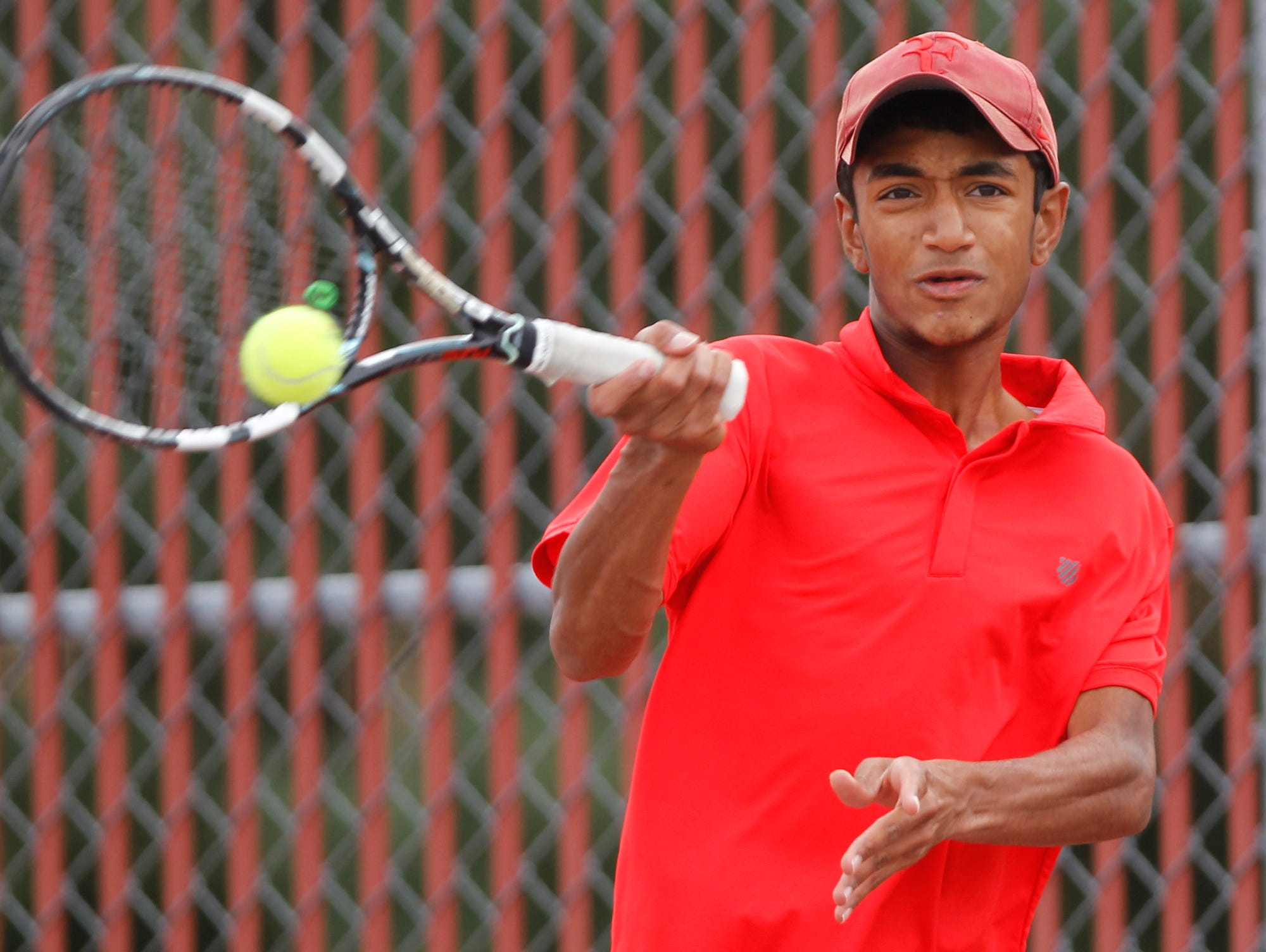 West Lafayette's Arjun Ramani with a return against Lafayette Jeff's Ryan Walker in No. 2 singles during the boys tennis sectional championship Friday, October 2, 2015, at Cumberland Courts in West Lafayette.