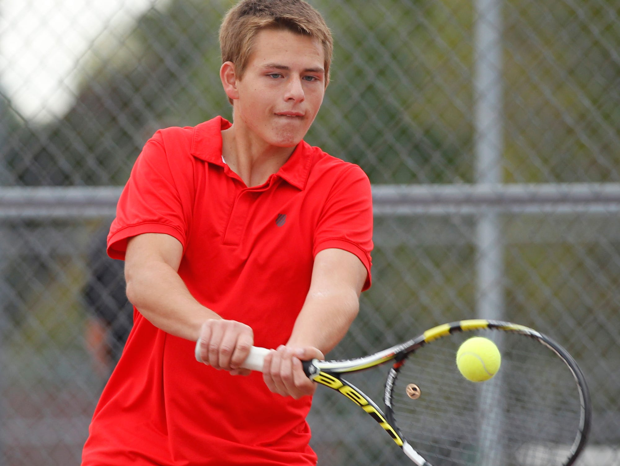 West Lafayette's Eric Malone battles Lafayette Jeff's TJ Preston at No. 3 singles during the boys tennis sectional championship Friday, October 2, 2015, at Cumberland Courts in West Lafayette.