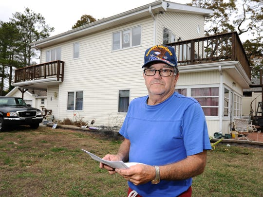 Wilson Coale of Riverdale, near Millsboro, holds his water bill for using 428,120 gallons of water.