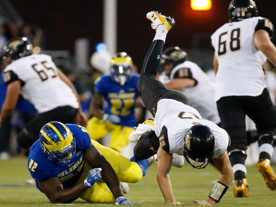 Delaware's Bilal Nichols gets a shot at Towson quarterback Heath Dahlgren in the fourth quarter of Delaware's 20-6 win at Delaware Stadium Saturday.