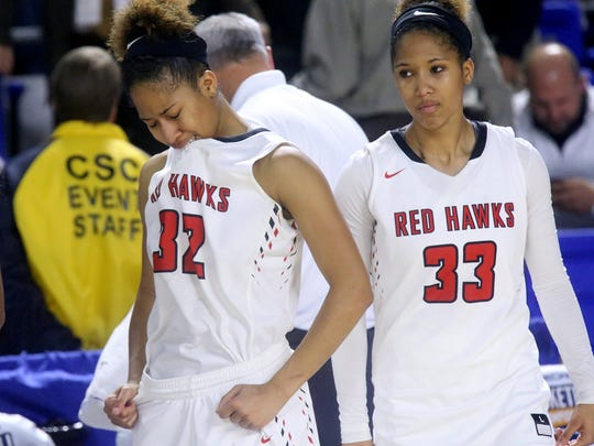 Stewarts Creek's Brianah Ferby (32) and  Brandi Ferby (33) react to the double overtime loss to  Dickson County 67-64 in the quarterfinal round of the Class AAA State Tournament on Wednesday, March 8, 2017.