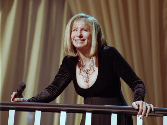 Barbra Streisand reacts to her fans' applause as she enters the stage to perform Sunday, May 15, 1994, at the Palace of Auburn Hills.