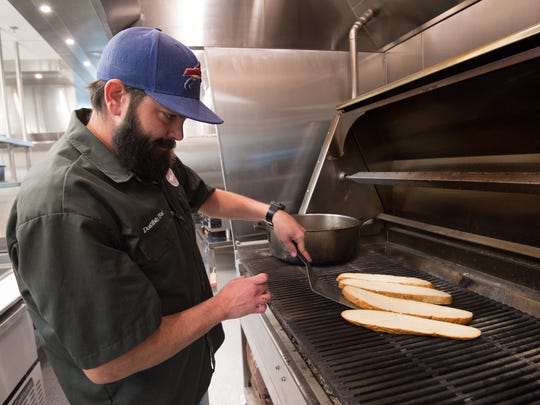 Executive chef, Zach Dick, grills the bread for the