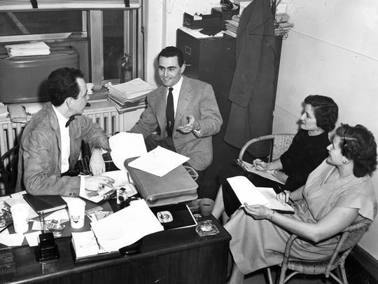 """800 Broadway Building, Downtown: The low-ceiling office floors in the Taft family's old Cincinnati Times-Star newspaper building Ð now used by the Hamilton County juvenile and domestic relations courts Ð was the original home of Taft's WKRC-TV, which aired the first Rod Serling (center in photo, talking to producer Bob Huber) TV dramas on ÒThe StormÓ (1951-52) before he created """"The Twilight Zone."""""""