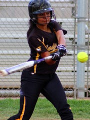 Alamogordo senior Sarena Maynez makes contact with the ball Friday evening. Alamogordo swept Clovis 9-0 and 10-0.